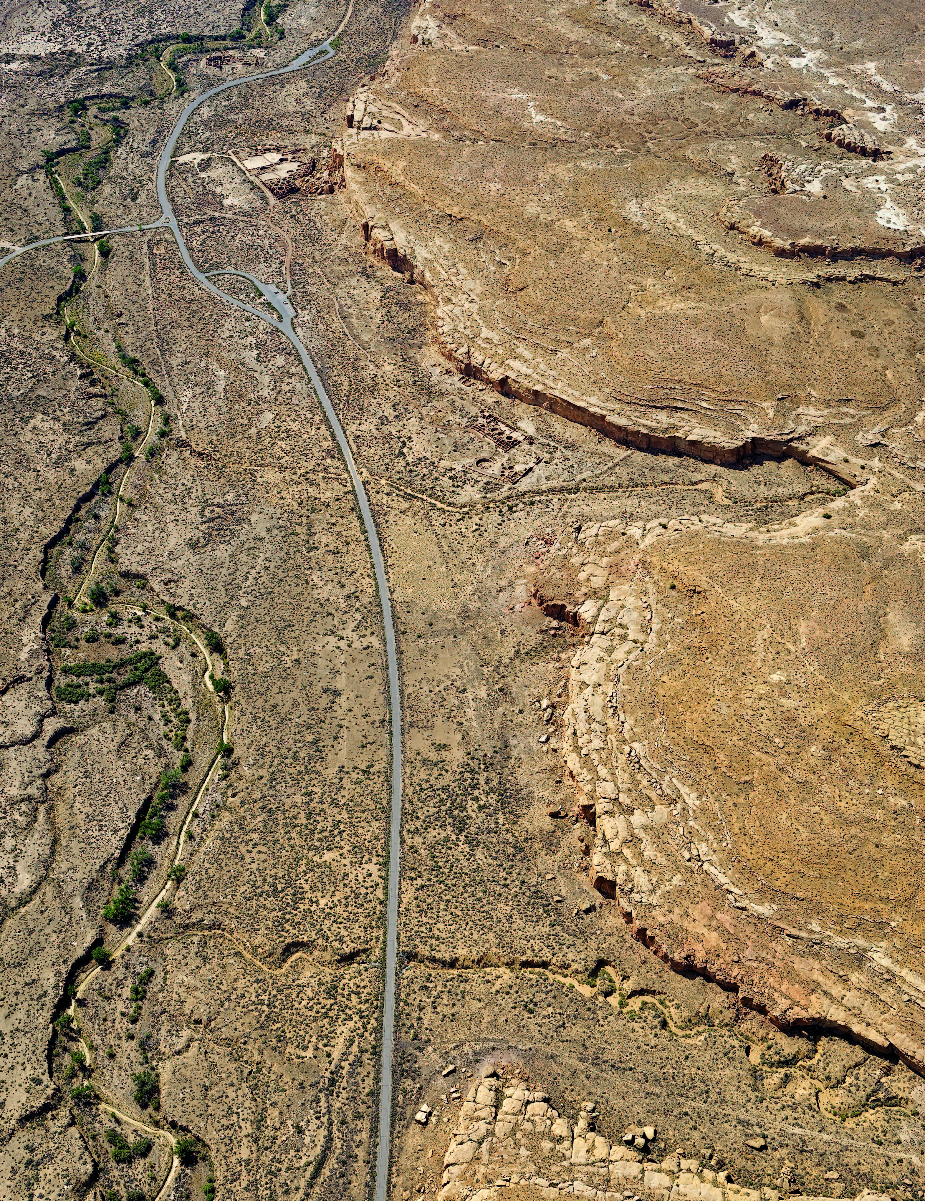 The minimal shadows cast by cliffs and walls in this photograph from 2008 show that it, like its matching Lindbergh image, was taken sometime close to noon. The Park Service had removed historic structures, believing that they distracted from the Chaco Culture structures and features that the park was established to protect. Photograph by Adriel Heisey, 2008. Both photographs are from Oblique Views: Aerial Photography and Southwest Archaeology, by Charles A. Lindbergh, Anne Morrow Lindbergh, and Adriel Heisey, edited by Maxine E. McBrinn, with essays by Linda J. Pierce and Erik O. Berg (Santa Fe: Museum of New Mexico Press, 2015
