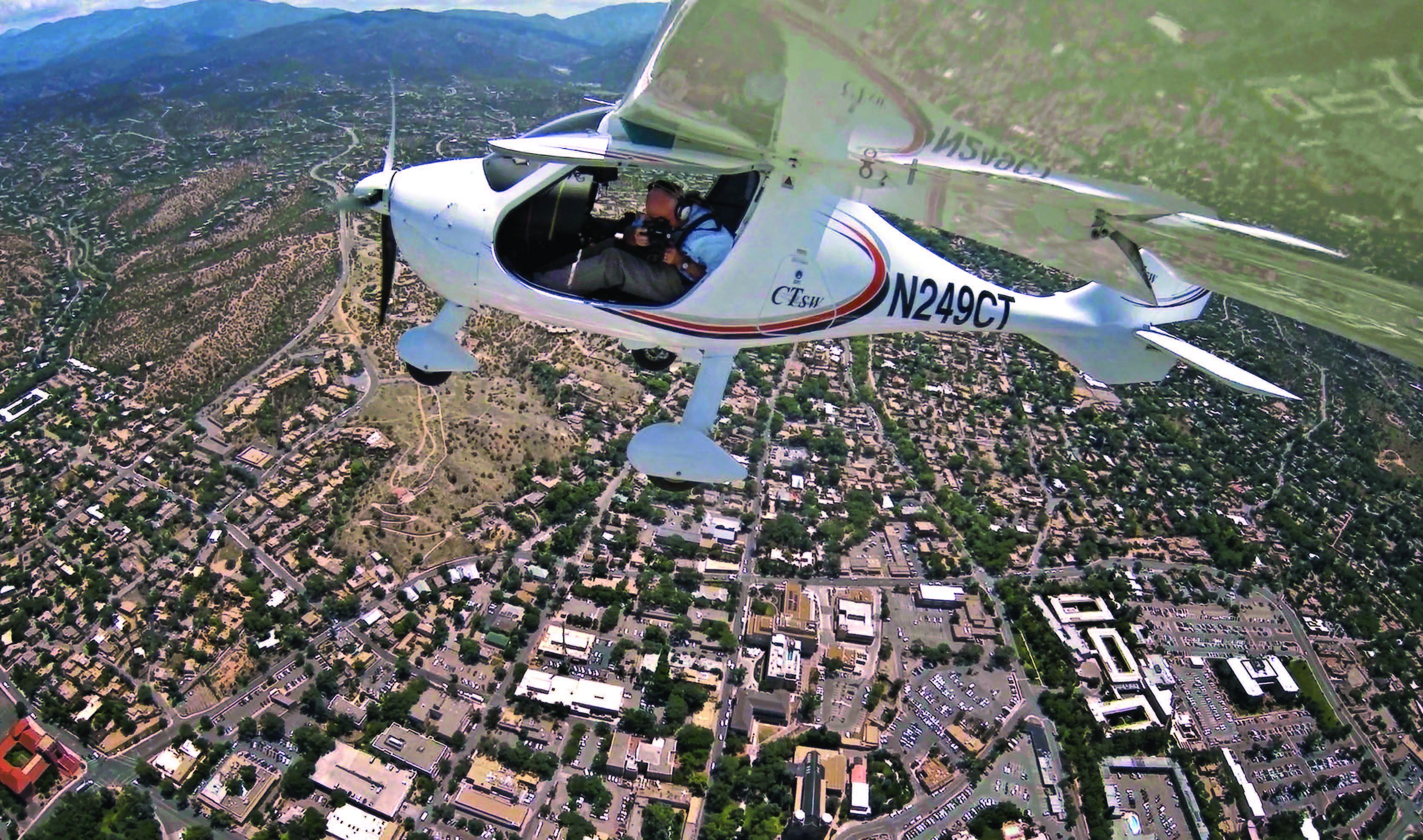 Adriel Heisey in flight over Santa Fe, 2015. Photograph by Adriel Heisey.
