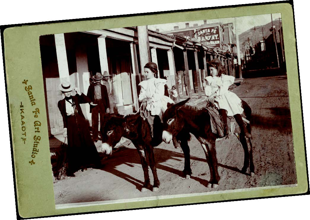 Genevieve Harrison (Dunlavy) and Helen Harrison (Fiske) on burros, West San Francisco Street, Santa Fe, ca. 1900. Photograph by C. G. Kaadt. Palace of the Governors Photo Archives (NMHM/DCA), Neg. No. 011341.