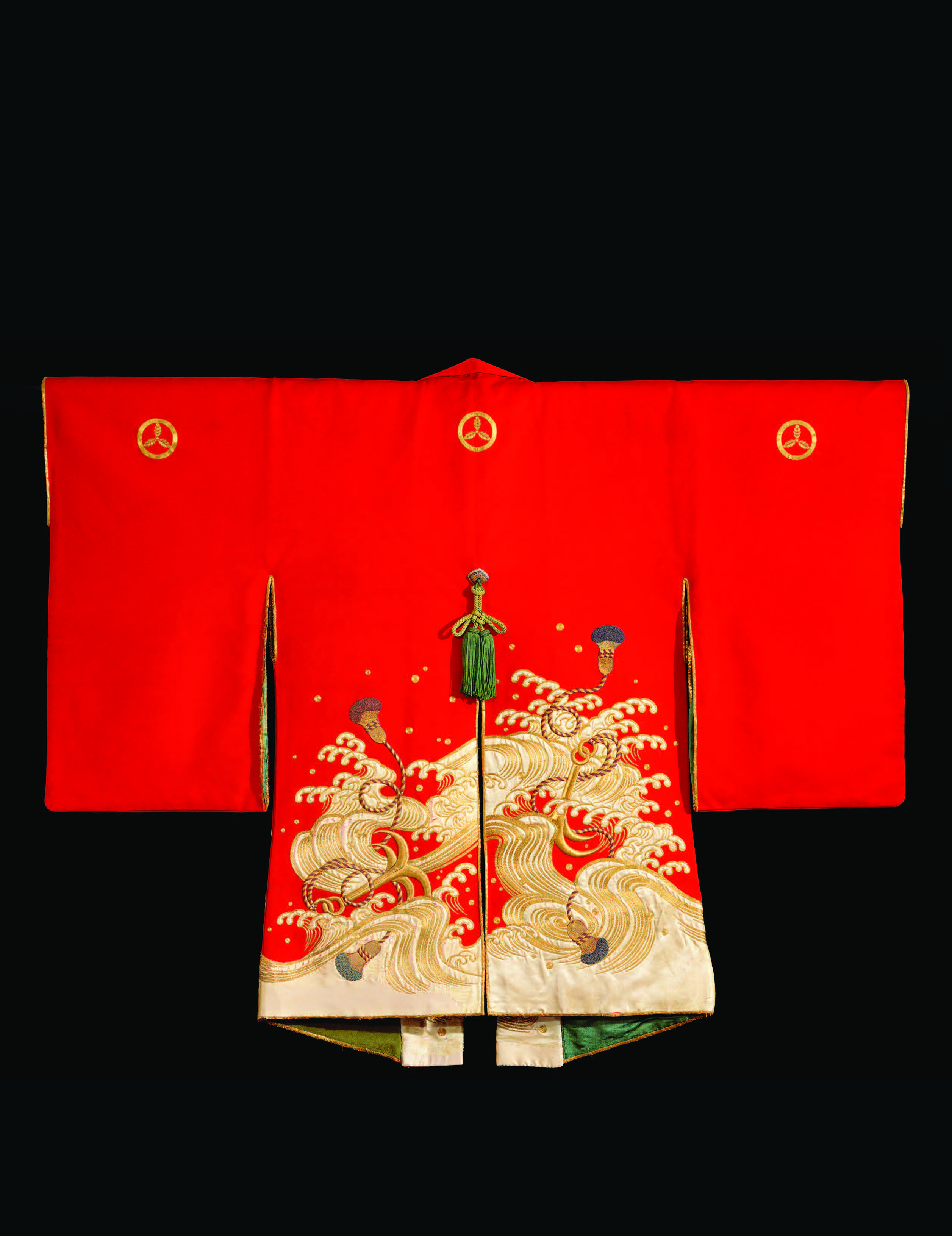 Firefighter's ceremonial coat (kajibanten), Japan, eighteenth– nineteenth century, Edo period. This cochineal-dyed cape was likely only used for ceremonial purposes. A sturdier coat, often made of leather, would be worn during firefighting. Wood with gold- and silk-thread embroidery and appliqué, 38 × 48 in. John C. Weber Collection. Photograph by John Bigelow Taylor.