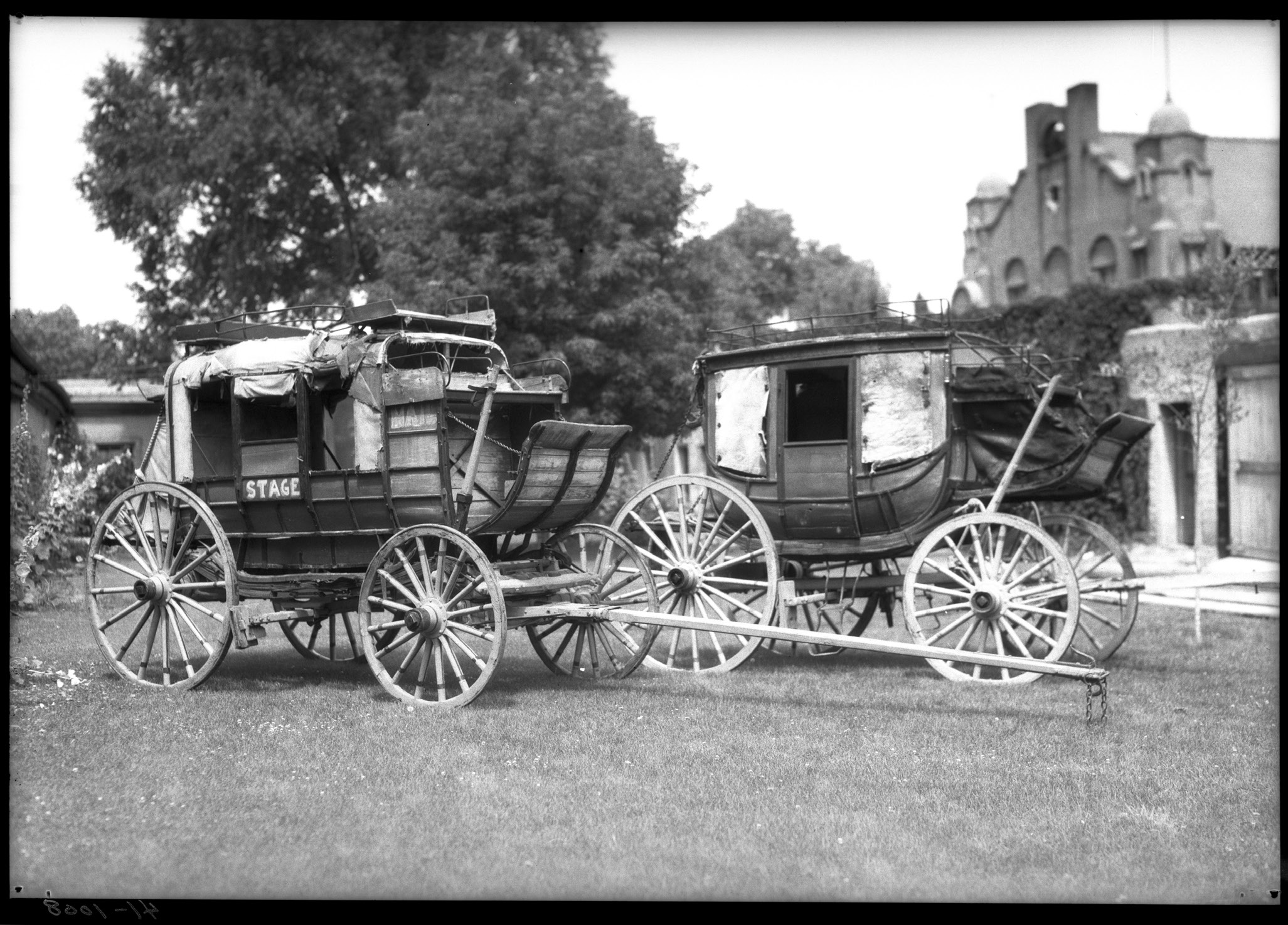 Two Barlow, Sanderson stagecoaches presented to the Historical Society of New Mexico by Mrs. Arthur (Frankie) Seligman, Palace of the Governors courtyard, Santa Fe, New Mexico, 1935. Palace of the Governors Photo Archives (NMHM/DCA), Neg. No. 011942.