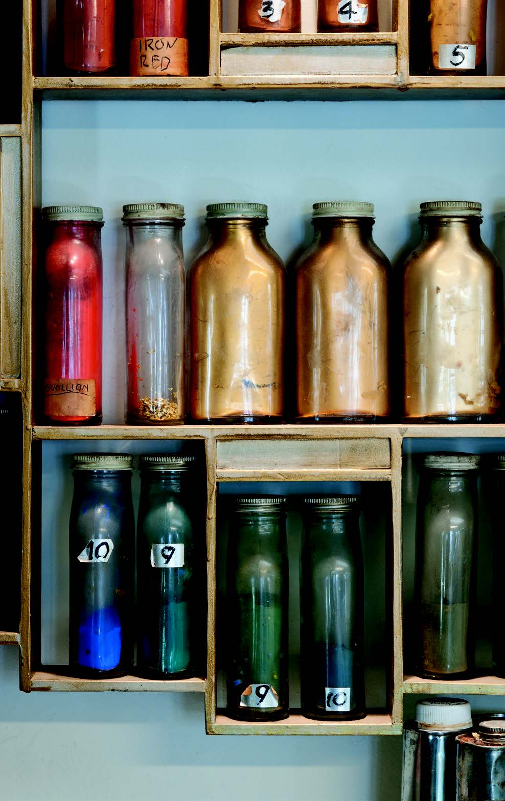 Some of Baumann's colorful pigments, neatly stored in pharmaceutical bottles. All objects Collection of the Press at the Palace of the Governors, New Mexico History Museum. Photographs by Blair Clark.