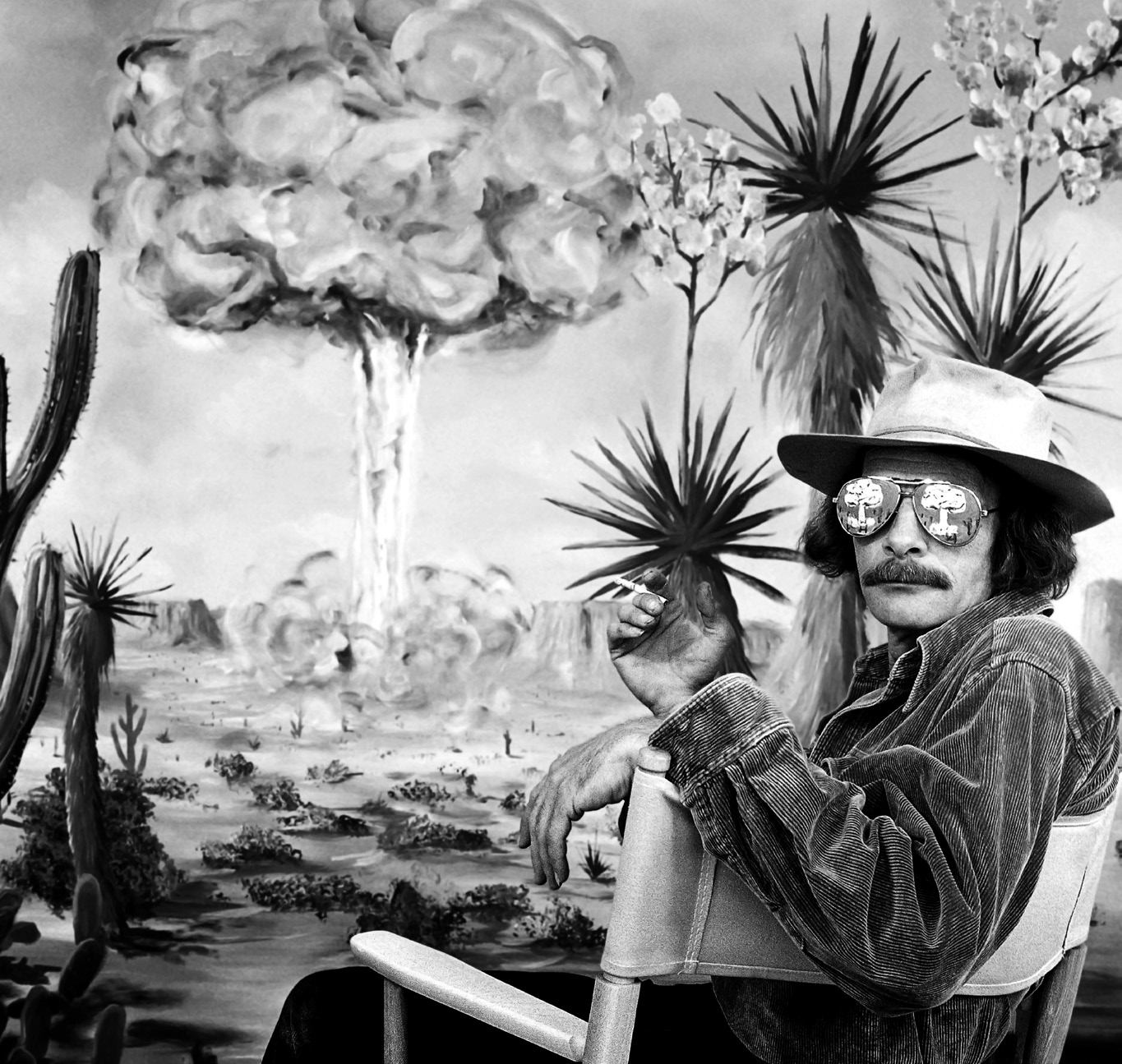 Elliott McDowell, Tony at Yucca Flats, 1982. Taken at McDowell's studio in Tesuque. Price painted the mushroom cloud on the backdrop and on his glasses. Courtesy of Elliott McDowell.
