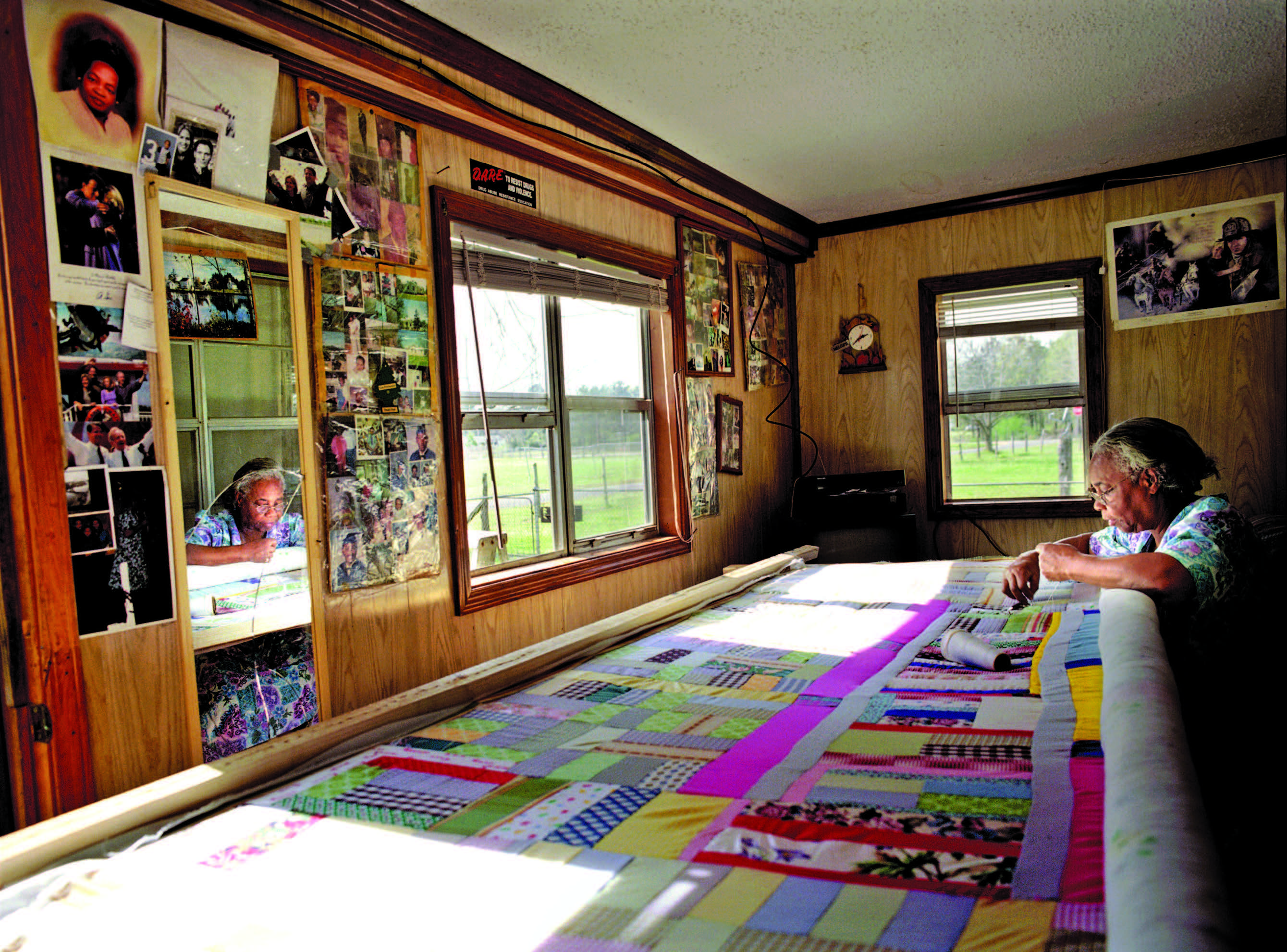 Mary Lee Bendolph, born 1935, quilting in her home, 2003. Photograph by Linda Day Clark.