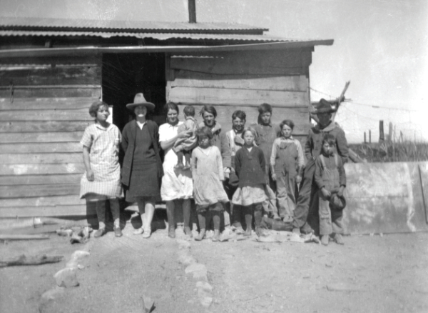 School group at the Gililland Ranch. Back row— Unknown, Miss Le wich, teacher, Alice Gililland holding Lola Gililland, Emmett Henderson, Andy Henderson, Sam Gililland, Hodges Henderson, and Frank Martin. Front row—Dixie Gililland, Bera Martin, and unknown, 1926-27.