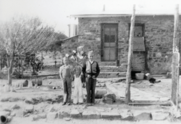 Charles H., Fred, and Joe Pete Wood at the Wood Ranch home, 1935.