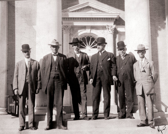 Political group at Governor's Mansion, Santa Fe, New Mexico, ca. 1910-1911. Pictured left to right; Harry W. Kelly, Holm Bursum, Albert B. Fall, Governor William Mills, Dr. J.M. Cunningham, and unidentified. Photograph by Walton. Courtesy Palace of the Governors Photo Archives (NMHM/DCA), neg. no. 102043.