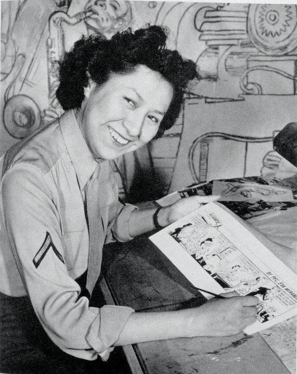 """Eva Mirabal drawing her first G.I. Gertie cartoon, 1944. Photograph by AAF Air Service Command. This photo was published in the July 1944 issue of New Mexico Magazine in a full-page spread titled """"G.I. Gertie."""" The caption reads: """"Pfc. Eva Mirabal's first assignment was to draw a comic strip for WAC publications."""" Courtesy collection of Coming/Gomez."""