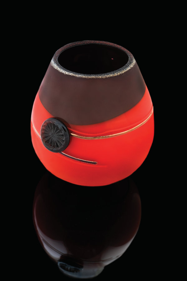 Tony Jojola (Isleta Pueblo), untitled, 2014. Blown glass with silver stamps. 8 1/10 × 74/5 in. MIAC Collection: 59229. Photograph by Kitty Leaken. Courtesy the Museum of Indian Arts and Culture.