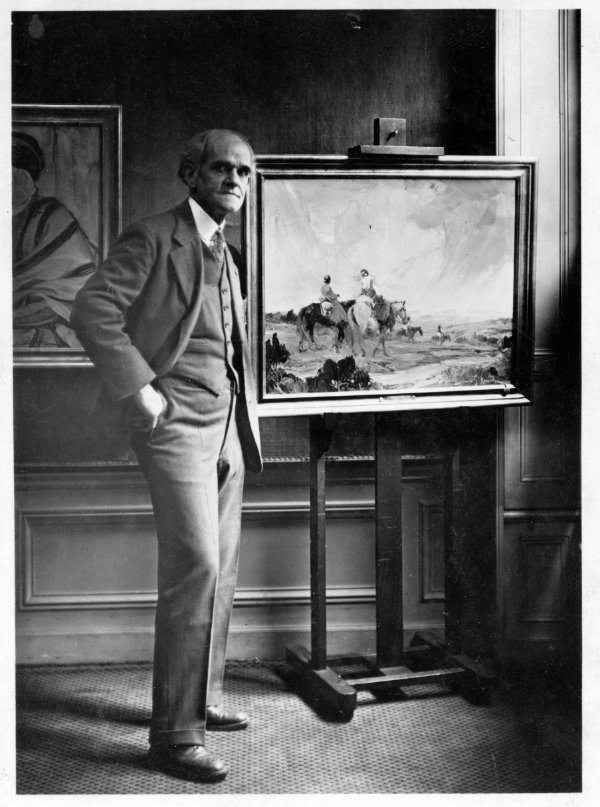 Gerald Cassidy with his painting, Navajo Romance, which was purchased by the French government for the Luxembourg Galleries in Paris, n.d. Courtesy the Hewett Collection, the Palace of the Governors Photo Archives (NMHM/ DCA), neg. no. 007121.