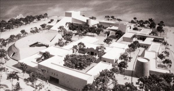With the choice of the Barelas neighborhood location at Bridge (now Avenida Dolores Huerta) and 4th streets, the original campus plan was condensed to fit the 16-acre site. Noticeably absent in this revised design is the charreada lienzo (rodeo arena). The design focused on pedestrian access to the renovated historic elementary school (today's History and Literary Arts Building), a visual arts building with numerous museum galleries, a performing arts building with three theaters, an international and education building housing the Instituto Cervantes, two torreóns (watchtowers) exhibiting art, and an amphitheater. Image courtesy the National Hispanic Cultural Center.