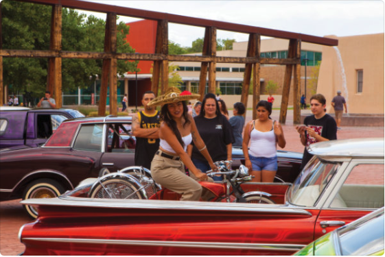 Locals celebrate Qué Chola, a 2019 exhibition at the Art Museum, in high lowrider style. Photograph by Addison Doty.
